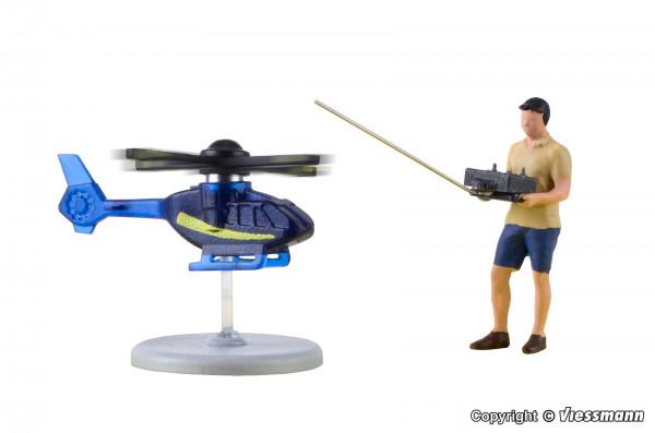 H0 Hobbypilot mit ferngesteuertem Hubschrauber